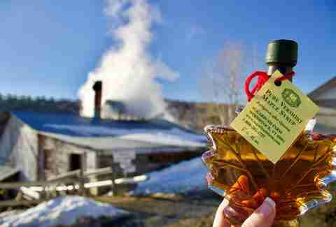 maple syrup in front of farm