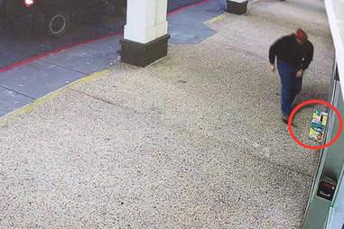 Man abandoning kitten in box
