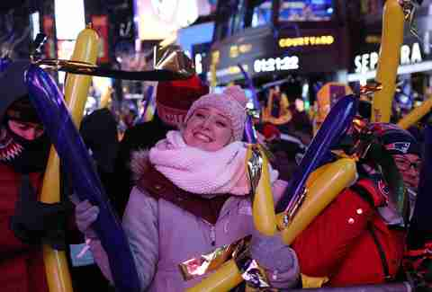 woman bundled up at nye