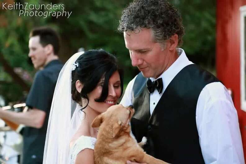 Bride and groom with rescue dog