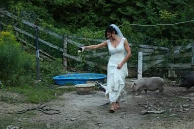 Bride feeding rescued pigs