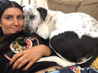 Lola snuggles up to her new mom, Cristina Antonucci