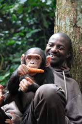 Smiling caregiver with rescued chimp