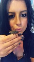 Woman holding grasshopper