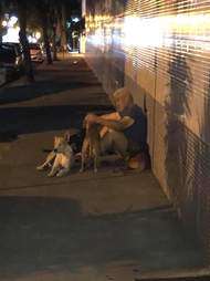 Luis the homeless man is reunited with his dogs
