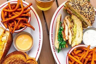East Hampton Sandwich Co. sandwich and sweet potato fries on a plate