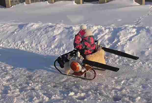 Best Dad Ever Gives Daughter's Sled a Turbo Boost by Attaching 2 Leaf Blowers