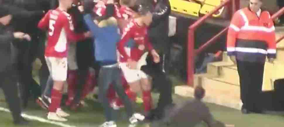 Celebrating Soccer Fan Somehow Manages to Kick His Own Team's Player in the Balls
