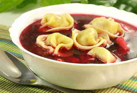 Red borscht with uszka in a bowl