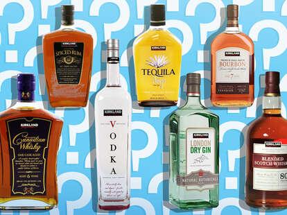 bottles of kirkland booze on blue background costco cheap alcohol liquor bottle drinks price