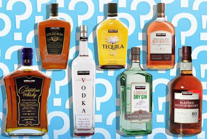 bottles of kirkland booze on blue background