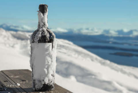 wine bottle covered in snow
