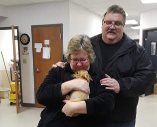 couple adopts puppy
