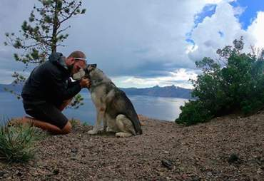 Guy and his adventure husky