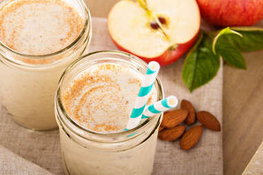 Apple Banana Cinnamon Smoothie in small jar with straw