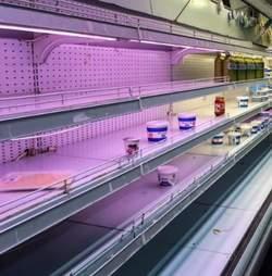 Empty grocery store shelf in Venezuela