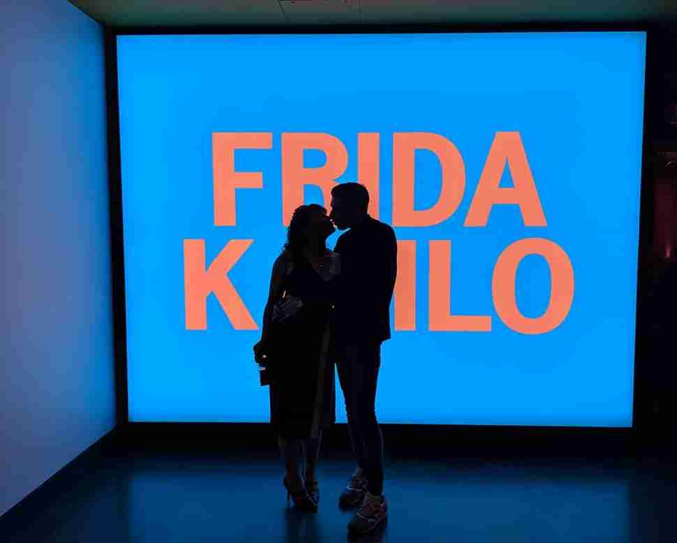 Brooklyn Museum people in front of Frida Kahlo screen