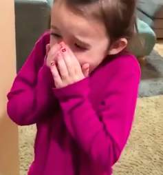 Little girl surprised by rescue dog
