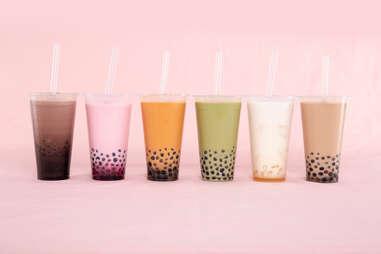 colorful different milk teas with boba thai tea strawberry matcha pearls tapioca drinks