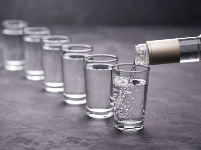 pouring vodka into glass vodkas liquor hard alcohol shot glasses shots buying guide thrillist