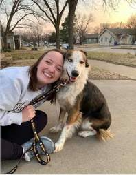Emily Gray with her new dog Buddy