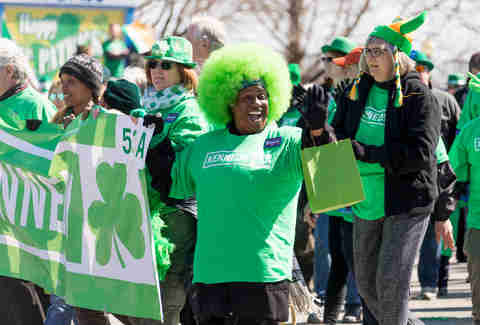 Marcher wearing green wig at chicago st patricks day parade