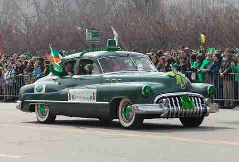decked out green car in parade