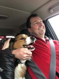 Jake the dog smiles on his way to his forever home