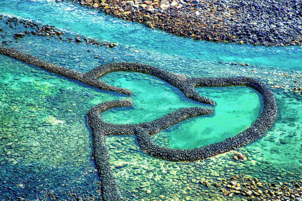 Twin-Hearts Stone Weir in Penghu Beach, Taiwan