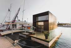 This Luxurious Floating Tiny Home Costs Just $55,000 & Can Be Assembled in a Day
