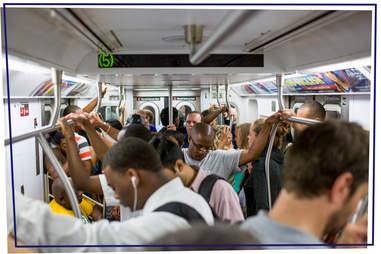 subway passengers standing