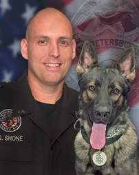 K9 Officer Greg Shone and his partner Titan