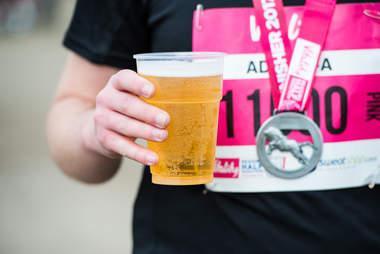runner holding beer