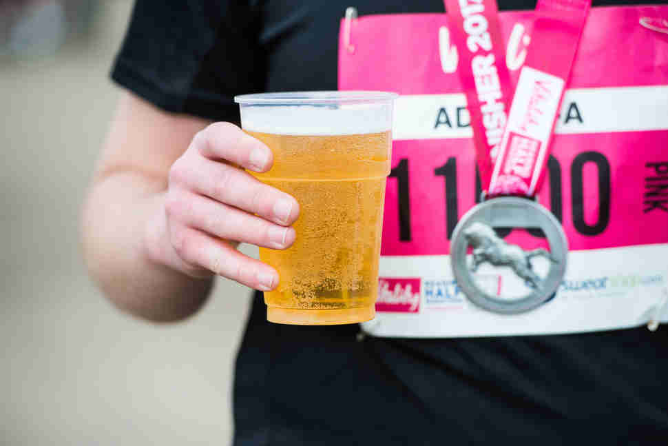 runner holding beer