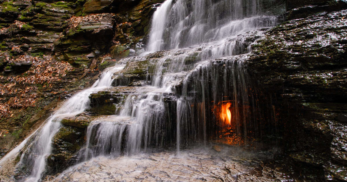 Hike to These Waterfalls Lit With an 'Eternal Flame' That (Almost) Never Goes Out