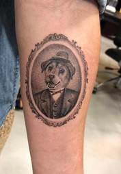 A tattoo of Jimmy the dog