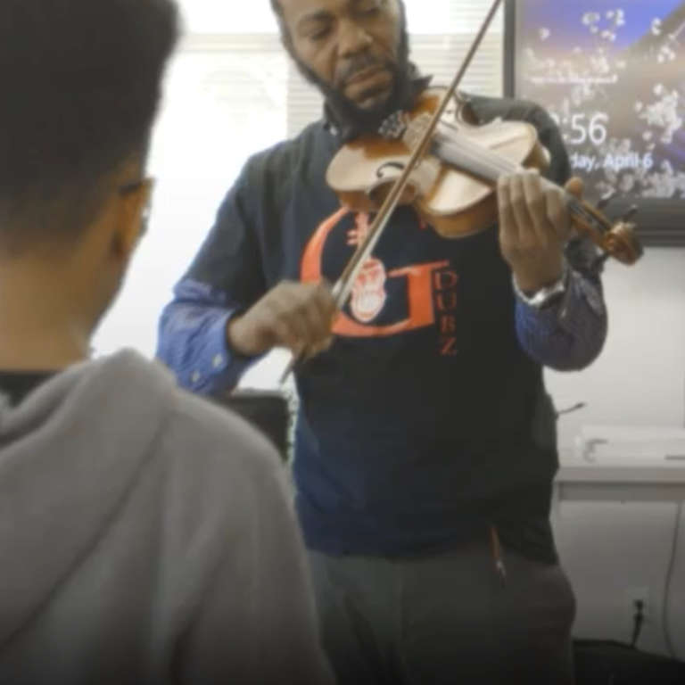 Music Teacher Heathcliff Sygapolho Gives Free Violin Lessons - NowThis
