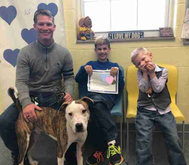 Dog and boy adopted on the same day