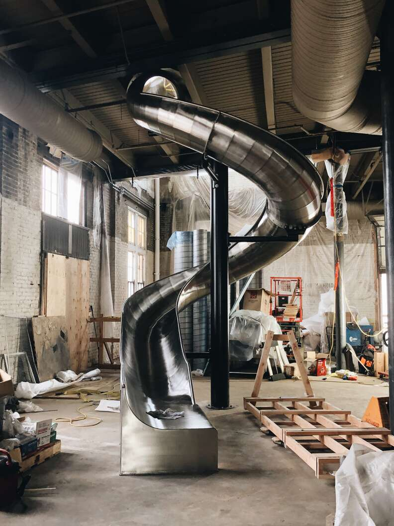 When it's completed, J. Rieger & Co.'s state-of-the-art distillery will feature a 40-foot-slide that guests can use to get from the bar to the exit.