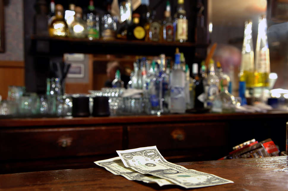 cash tip at a bar