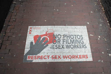 Close-up of spray painted sign on the floor of the Red Light District