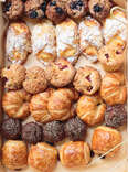 box of breakfast pastries croissants croissant pain au chocolat muffins cheese roll bread