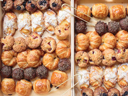 Box of breakfast pastries croissant croissant pain au chocolat muffins bread cheese bread