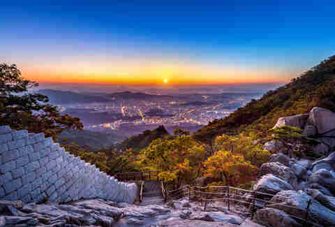 Sunrise at Baegundae peak and Bukhansan mountains