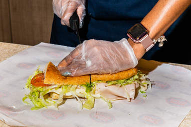 cold sub being cut