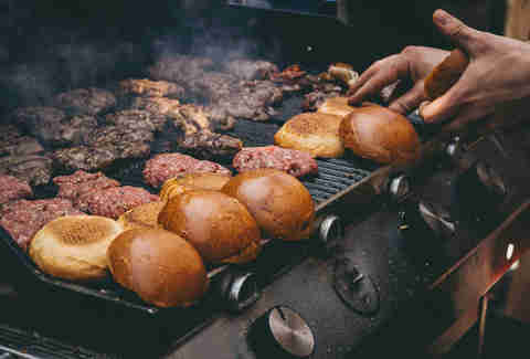 burgers and buns on grill
