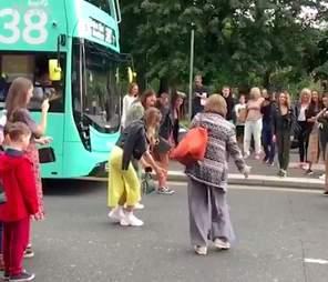 People helping ducks cross the street in Glasgow, Scotland