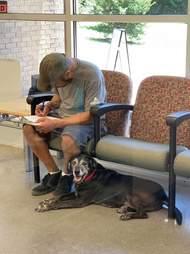 Homeless man fills out surrender paperwork at shelter