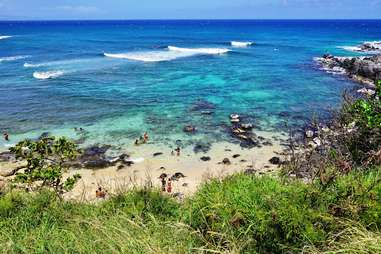 people wandering along crystalline water on the North Shore of Maui