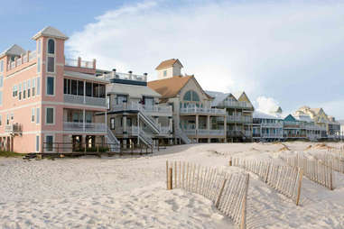 pastel-colored beach houses on the shore